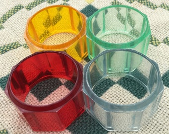Four beautiful vintage opaque plastic napkin rings