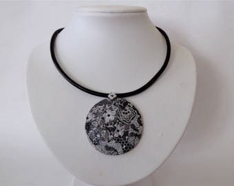 Leather necklace with large round pendant