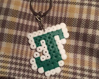 Customisable letter keyrings and magnets made using Hama/melty beads