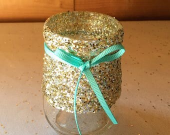 Small gold and silver glittered candle holder