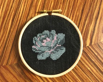 Grey rose cross stitch on upcycled denim