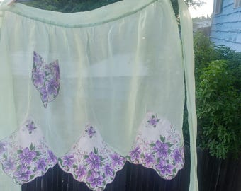 Vintage apron. Green with purple flowers.