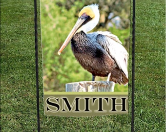"Pelican Personalized or Welcome Garden Flag, Swamp background ,  Brown pelican, Bird Flag, 12""x18"""