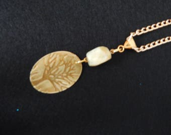 Gold embossed tree pendant