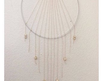 White dream catcher and wood