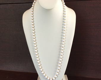 "Monet 30"" White Plastic Bead with Gold Tone Spacers Strung on Gold Chain Vintage Necklace"