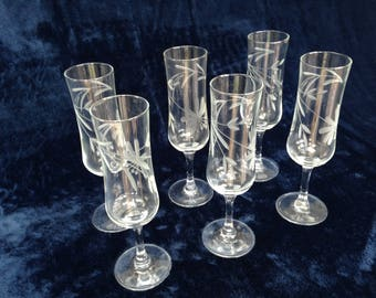 Vintage set of six cut glass champagne flutes with etched flower pattern