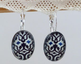 Glass cabochon earrings oval Navy Blue arabesques on white background