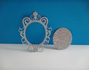 Cut silver glitter mirror frame