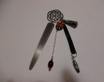 Bookmarks in red and black steel, the Grasshopper and Ladybug.