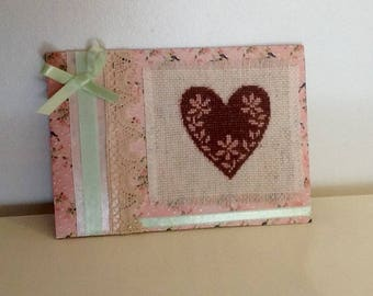 Frame retro heart embroidered on floral background