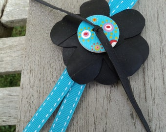 Brooch in inner tube recycled, colorful button and blue style Ribbon Cockade