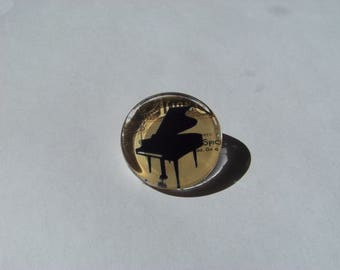 Beautiful cabochon 25 mm round and flat with image of piano music