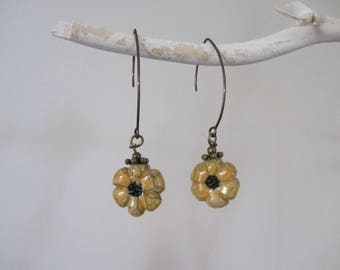 long bronze hook and flower dangling raku pottery mustard yellow