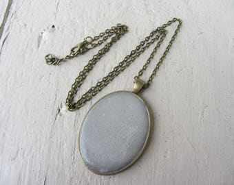 Raw and refined Necklace: Locket pendant oval bronze metal and gray concrete, urban adjustable necklace set