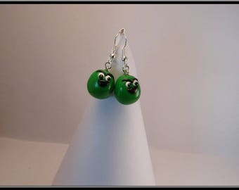 Earrings celebrates peanut chocolate coated in polymer clay.