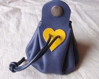 Coin purse is blue leather with yellow heart