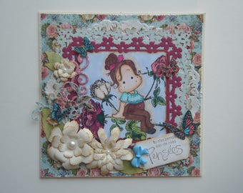 Card floral with a little girl sitting in flowers