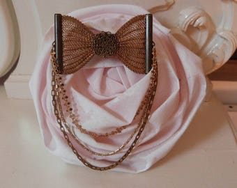 Triple strand of fancy collection Julia chains and vintage mesh bow brooch