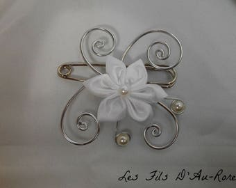 Attached behind flower white satin and silver aluminum wire