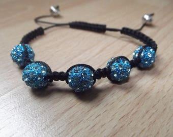 Shamballa bracelet with blue beads.