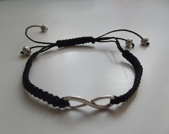 Black polyester with an infinity bracelet.