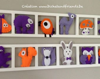 Child and baby room wall decoration. Orange and purple tones.
