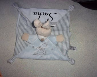Cuddly stuffed rabbit with blue pacifier personalized head