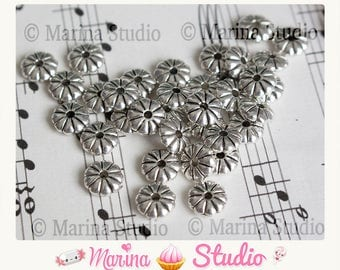 Set of 20 beads / slices / spacer flower silver 7x2mm (ms00541))