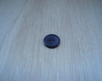 Brown button with an edge on are outline
