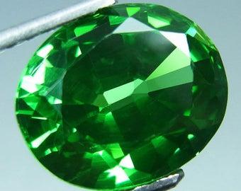 Tsavorite, Green Tsavorite of 7.65  carats, 11 mm by 9 mm by 6 mm, Oval brilliant faceted, Tsavorite