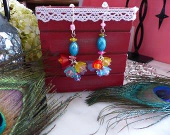 A pair of earrings multicolored flowers