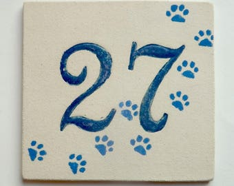 Plate stoneware number 27, bedroom door cat paws
