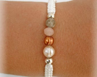 Braided bracelet adorned with pearls, Crystal and coral stone Ref: M006