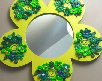 Mirror shaped flower with white clay flowers
