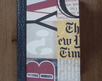"""Newspaper"" black binder notebook"