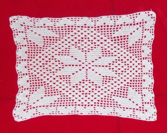rectangular doily crocheted by hand with patterns of spikes