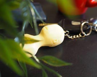 Ivory white resin head keychain sculpture