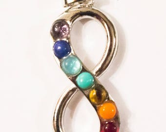Large infinity symbol pendant in brass and stone chakra gems
