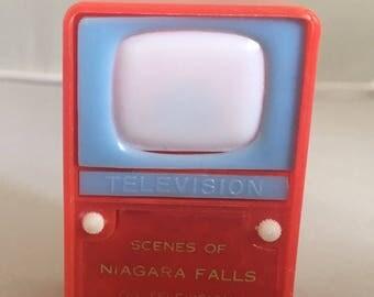 scenes of Niagara Falls on television souvenir from Niagara Falls Barbie doll size TV