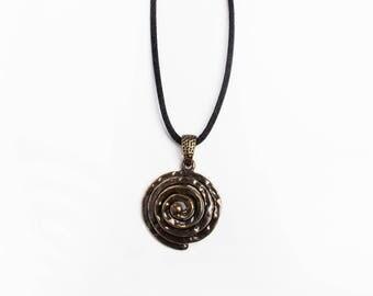 Spiral pendant dark gold