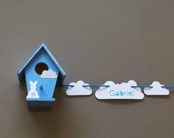 Decorative white and blue personalized birdhouse with Garland name