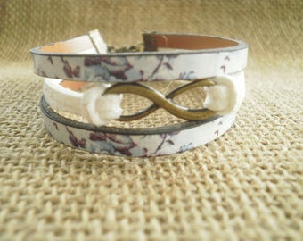 "Bracelet made of suede and faux leather, white and purple ""Infinity"" charm"