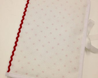 Health book has embroidery stitch pattern, cross little red hearts on white background aida canvas
