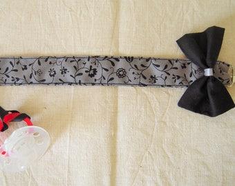 Clip - lollipop bow with flower motifs