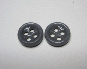 Gray round buttons four holes
