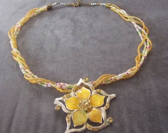Necklace silver medallion and yellow flower