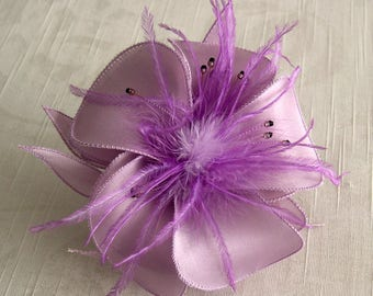 Purple satin flower brooch, feathers and beads