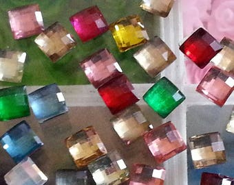 Perhaps 50 resin cabochons, including some people matte, faceted, square, mixed color, 6 x 6 x 2 mm