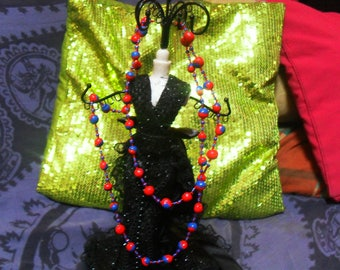 colorful necklace is made of polymer clay and beads